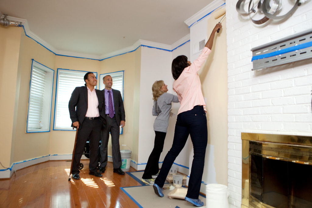 First Lady Michelle Obama and Dr. Jill Biden paint a wall in the home of Sergeant  Johnny Agbi, Jr., left, at a Joing Forces Initiative Heroes at Home event  in Washington, D.C., Oct. 17, 2011.  The retrofit on Sgt. Agbi's home to make it wheelchair accessible was the 1,000th home rebuild by the Rebuilding Together and Sears Heroes at Home programs. (Official White House Photo by Chuck Kennedy)